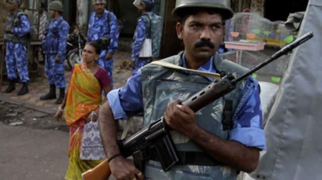 A woman goes to shop under heavy secuirityin Ayodhya