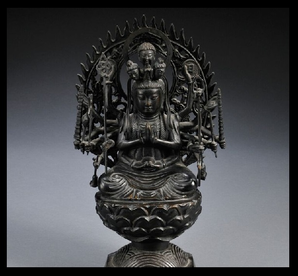 Buddha with four heads, many hands etc